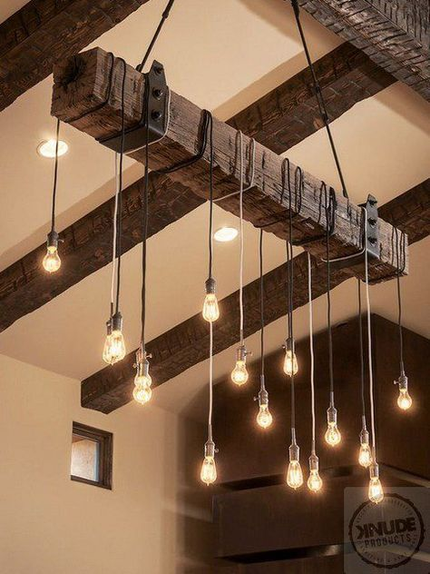 A stone wall, ceiling beams, and a barnlike admission add rustic .