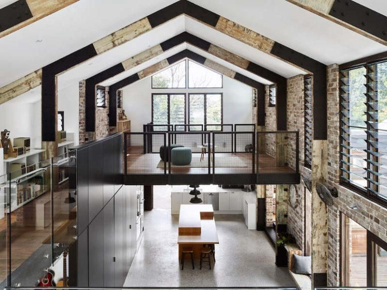 Industrial glass house residence with an open Layout Brisbane .