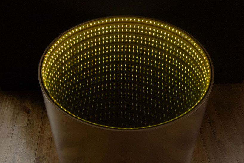 infinitum table's luminous surface encourages tidiness   Mirror .