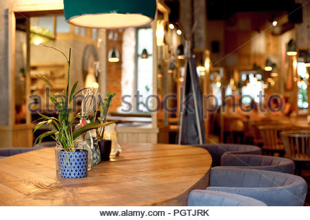 Modern loft style cafe interior in warm colors Stock Photo - Ala