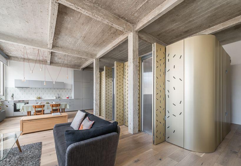 SABO project drops an aluminum island in a raw parisian loft .