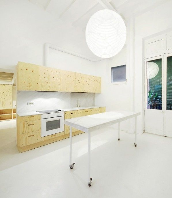Plywood Cabinets. By ARQUITECTURA-G, Photo via Jose Hevia .