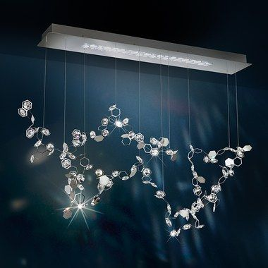 Fluttering crystal constellations hang from a geometric ceiling .