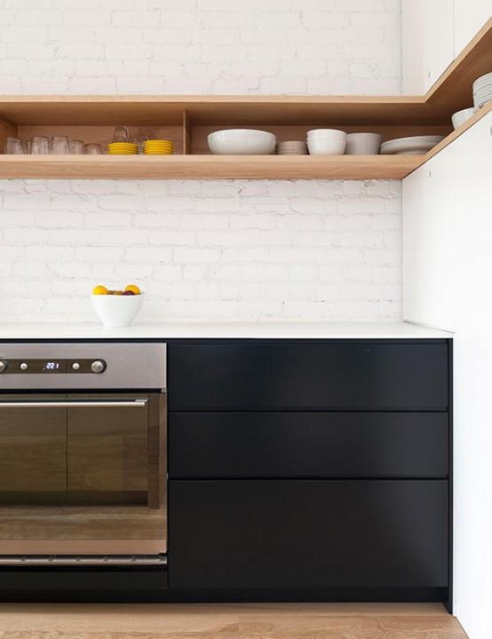 Minimal Black And White Kitchen With A White Brick Wall - DigsDi