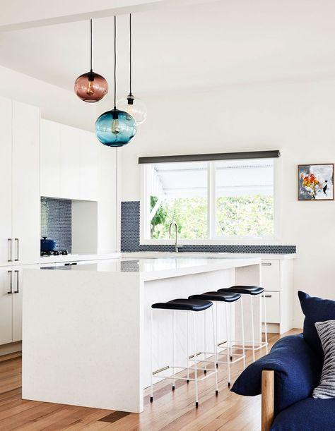 Open kitchen design in this minimalist Australian home .