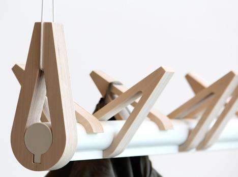 Hooks perch along coat rack to resemble resting bir