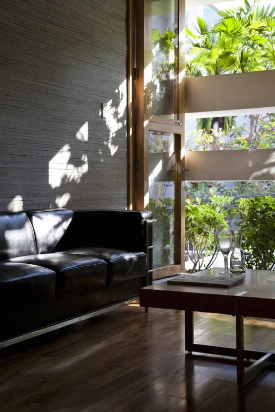 Minimalist Concrete House With A Large Vertical Garden - DigsDi