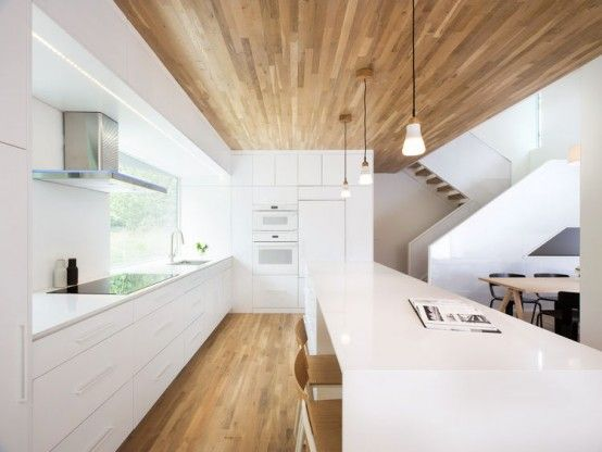Minimalist Home With Oak-Surfaced Interiors On A Tricky Site .