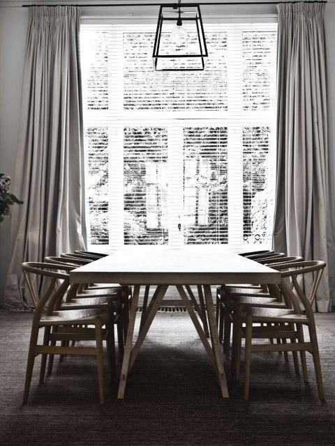 Floor-to-ceiling windows in a lofty dining room with horizontal .
