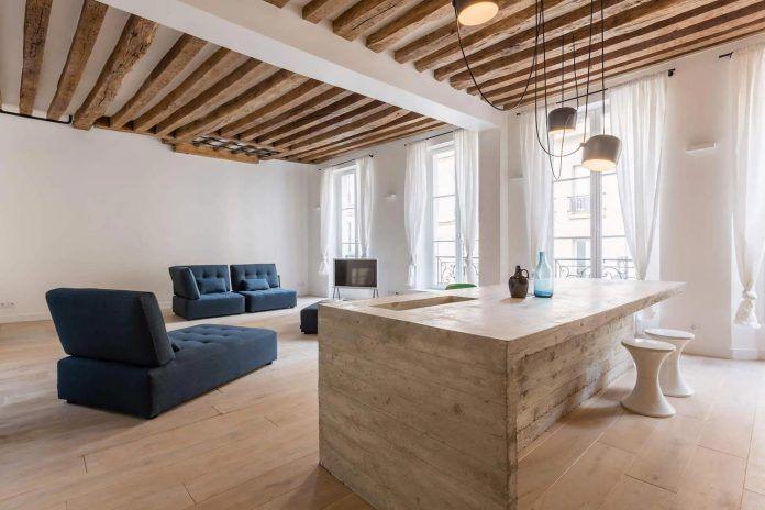 Minimalist apartment design focused on raw materials and pure .