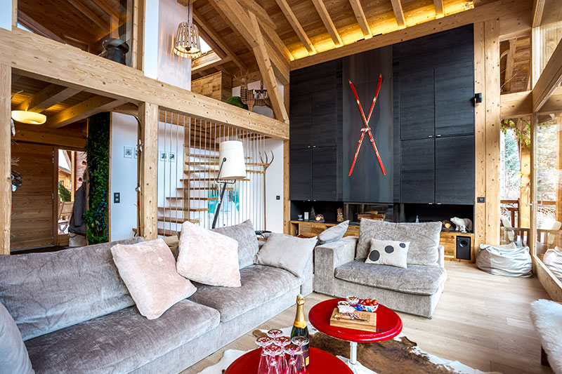 Chic modern chalet with red skis as decor and panoramic window in .