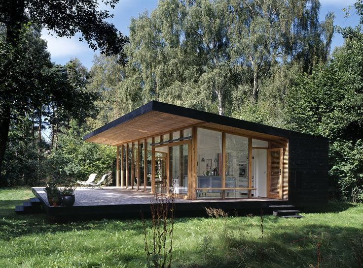 Black exterior with wood wraps, beautiful contrast to the nature .