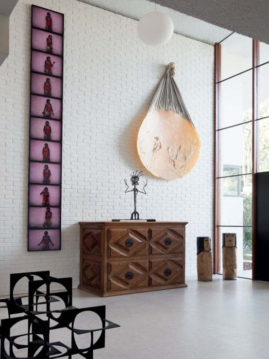 Modern Home Filled With Wood, Greenery And Artworks - DigsDi