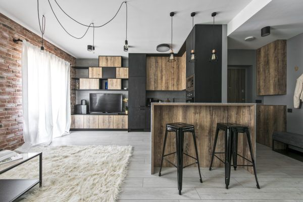 Small industrial apartment in Lithuania gets an inspiring update .