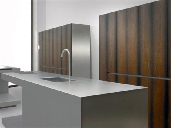Modern wood and metallic grey color minimalist two kitchen islands .