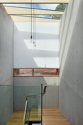 The main staircase features a skylight and double-height exposed .