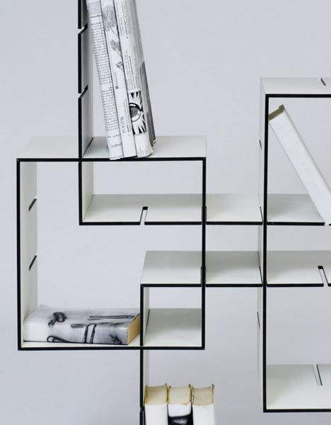 Slotted boxes that you can rearrange to make various shelves .