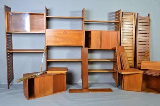 a Ladderax seven bay modular shelving system by Robert Heal on artn