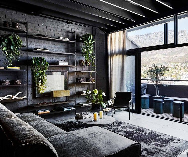 An industrial-style apartment with a dark and moody monochrome .
