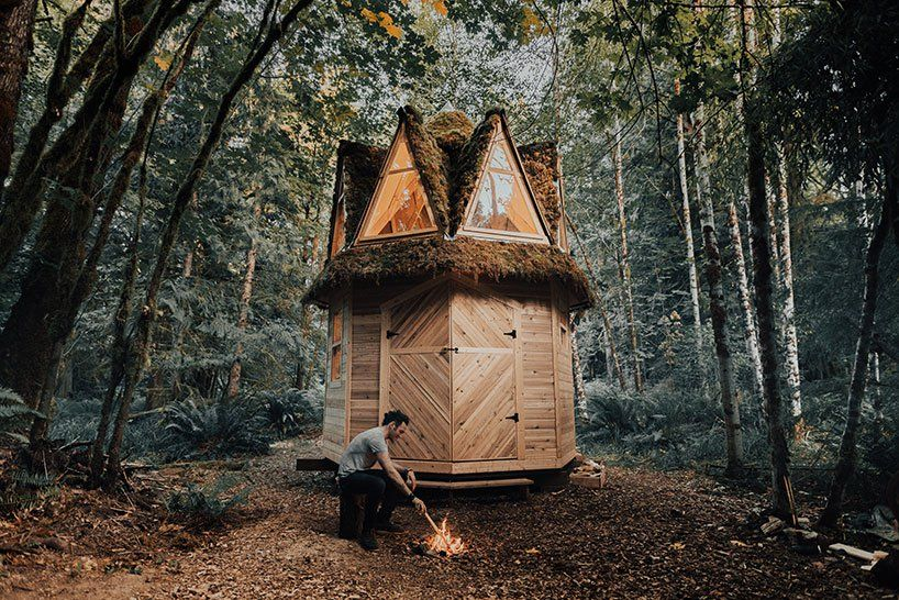 this tiny moss-covered cabin in the woods seems straight out of a .