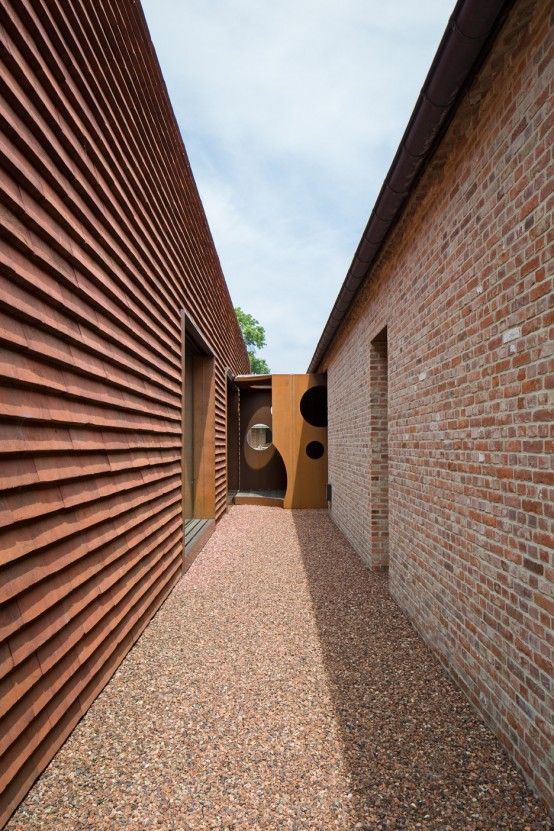 Olmen Farmhouse Covered With Terracotta-Colored Tiles - DigsDi