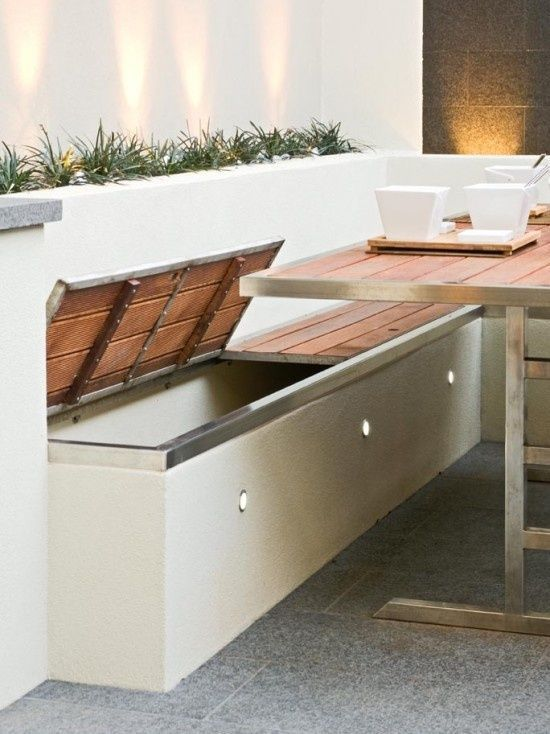Outdoor Living. Built in storage benches with outdoor accent .