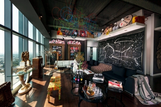 Eclectic furnishings in a stunning luxury apartment penthouse .
