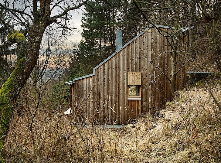 Tom's Hut is a tiny prefab timber cabin in the Austrian wilderne