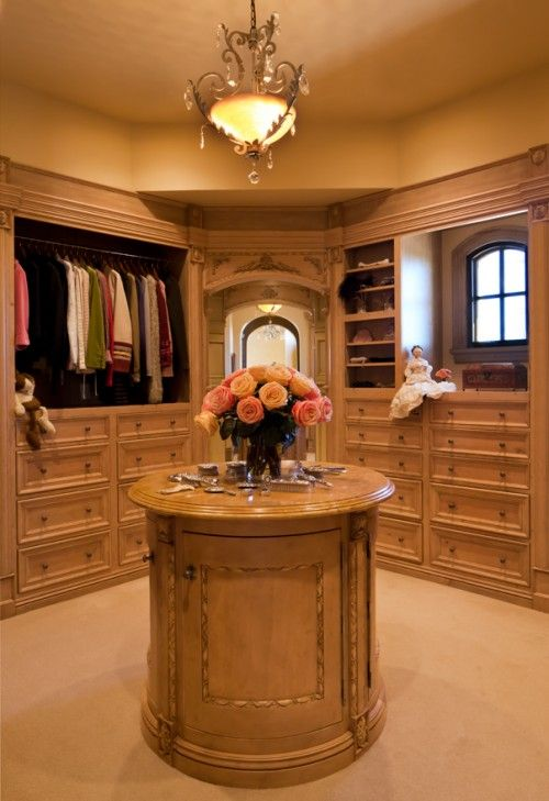 feminine dressing room with tiny arched window, round island .
