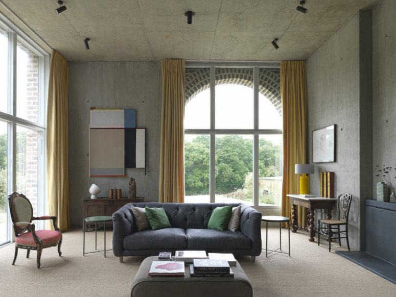 Minimalist Farmhouse In Raw Concrete With Bold Art - DigsDi