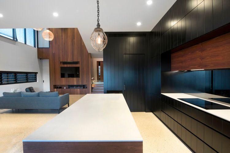 Caesarstone® Raw Concrete™. Everlong Joinery combines sleek black .