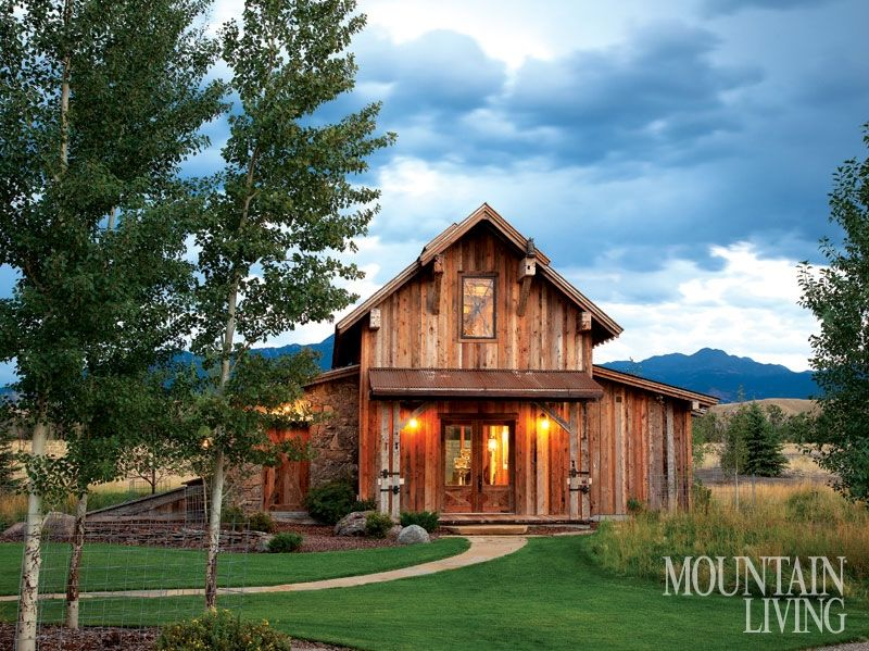 A barn-inspired home office and fitness center boasts inviting .