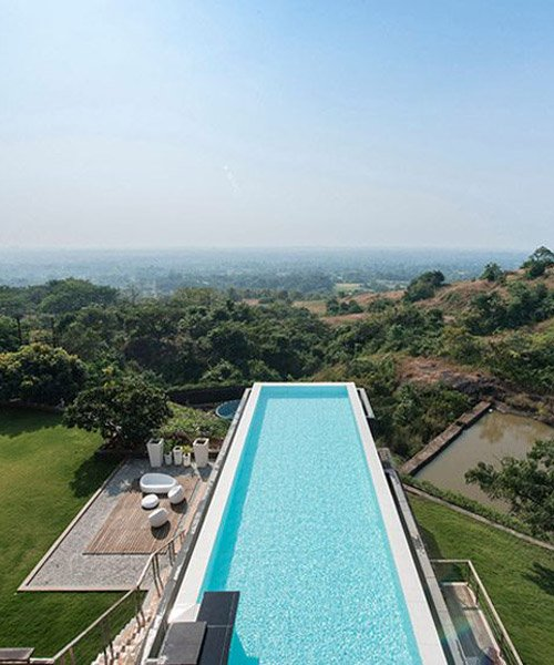 shroffleon designs rooftop infinity pool with uninterrupted views .