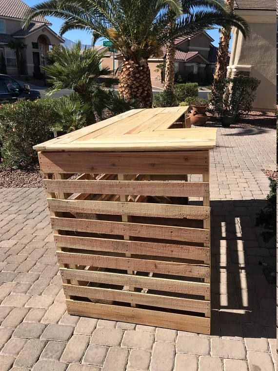 This pallet bar is made from recycled pallets. Stands .