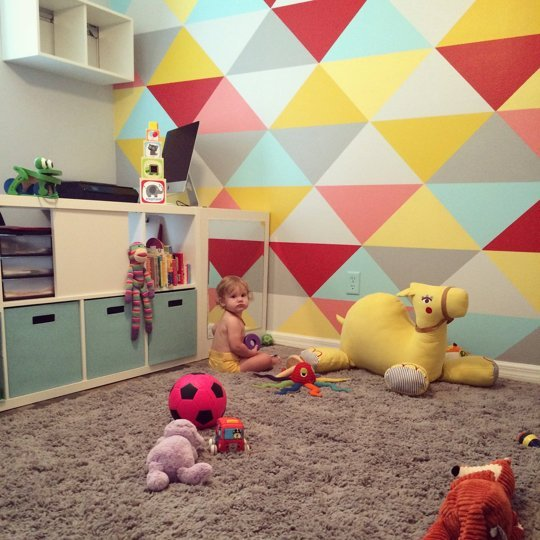 Small And Bold Kids Playroom Design With A Bold Geo Wall - DigsDi