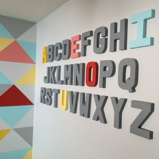 Small And Bold Kids Playroom Design With A Bold Geo Wall .