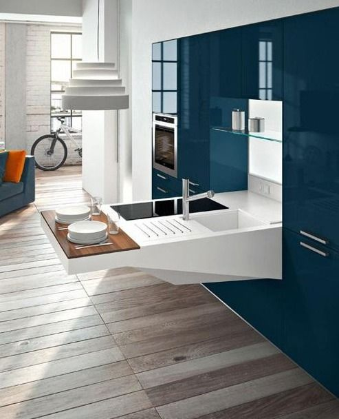 A compact kitchen design for small apartments by Snaidero .