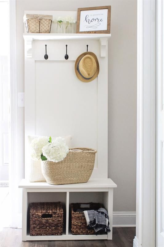 An entryway hall tree bench that is perfect for providing .