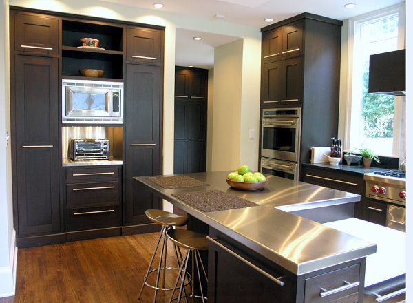 Stainless steel countertops brighten a kitchen with black .