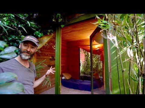Stealth tiny cabin in woods recreated in skinny SF backyard .