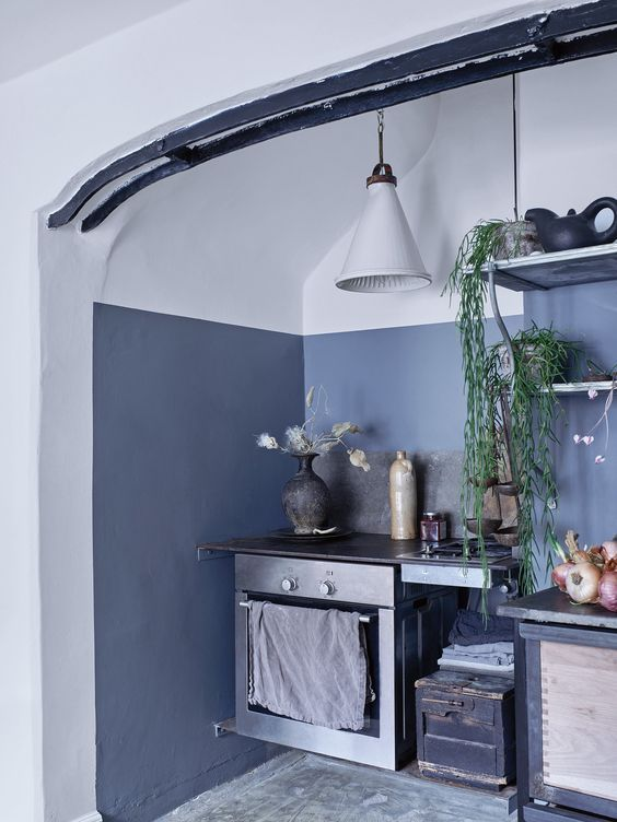 The kitchen is accentuated with asphalt grey, there's vintage .
