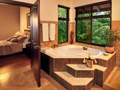 On suite Bathroom with hot tub, shower and toilet   House, House .