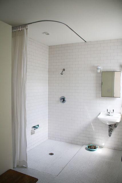 love this bathroom; looks like hospital ceiling track....all white .