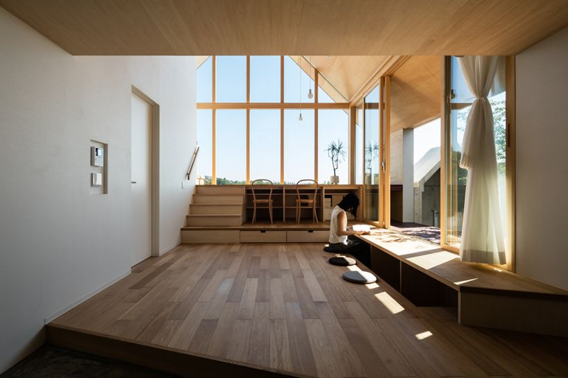 hiroto kawaguchi+kohei yukawa's wood-clad newtown house overlooks .